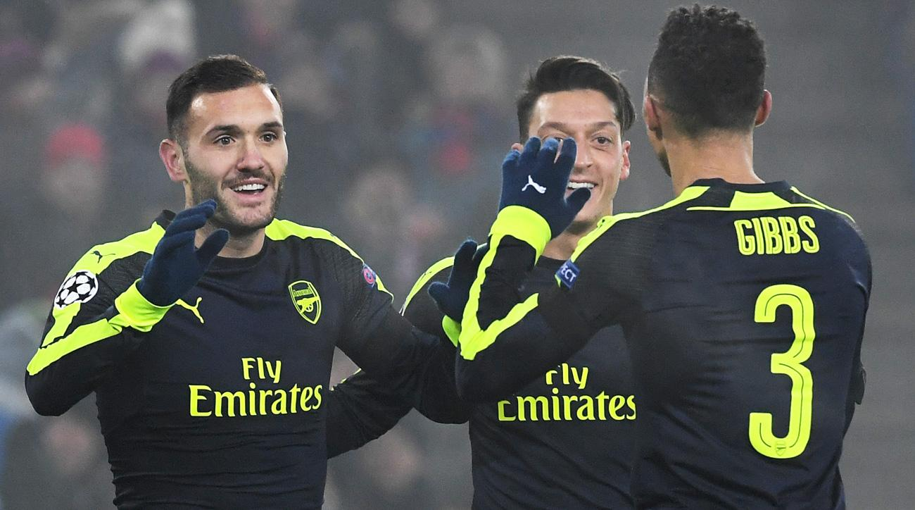 Arsenal wins its Champions League group, going unbeaten in the opening phase