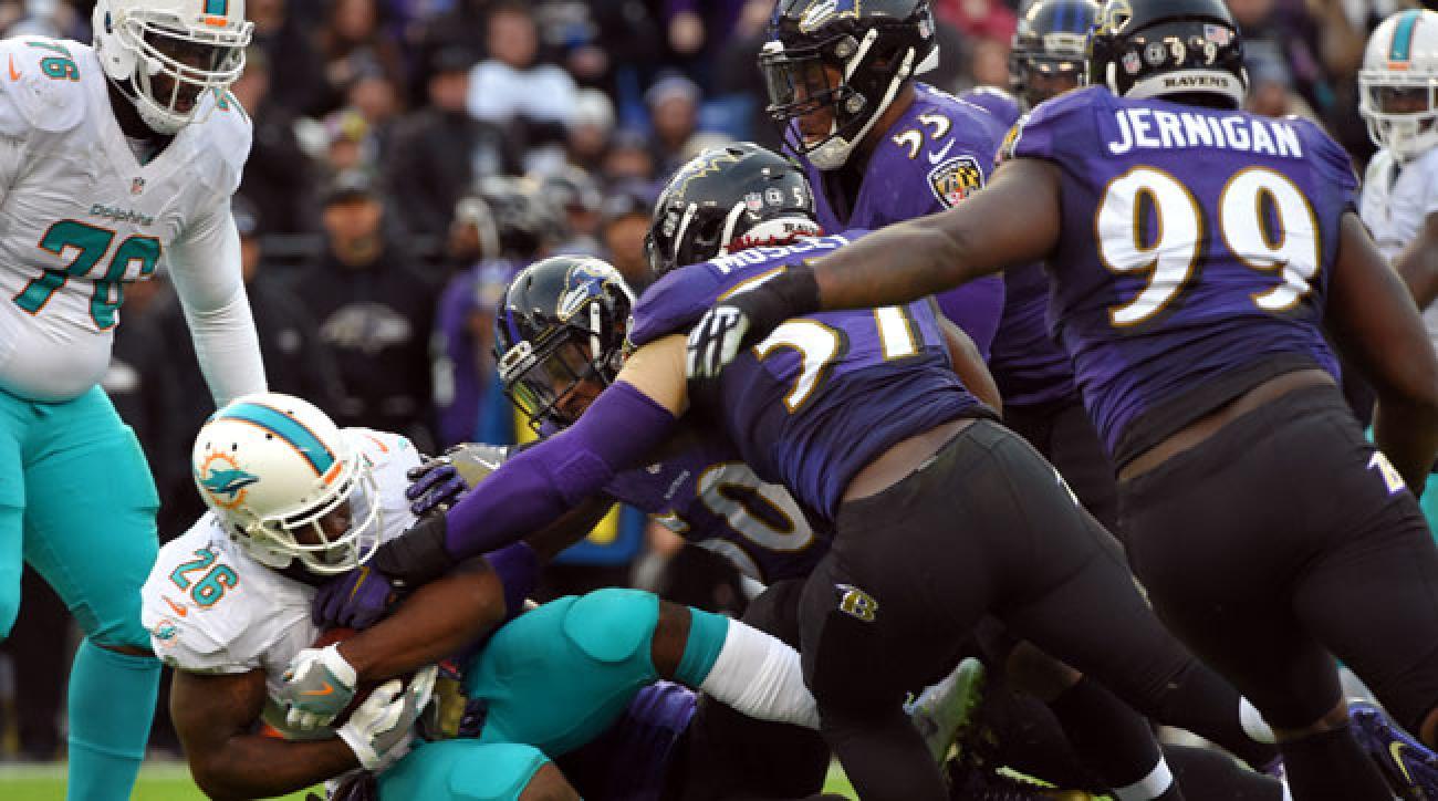 The Ravens D tackles Damien Williams at M&T Bank Stadium.
