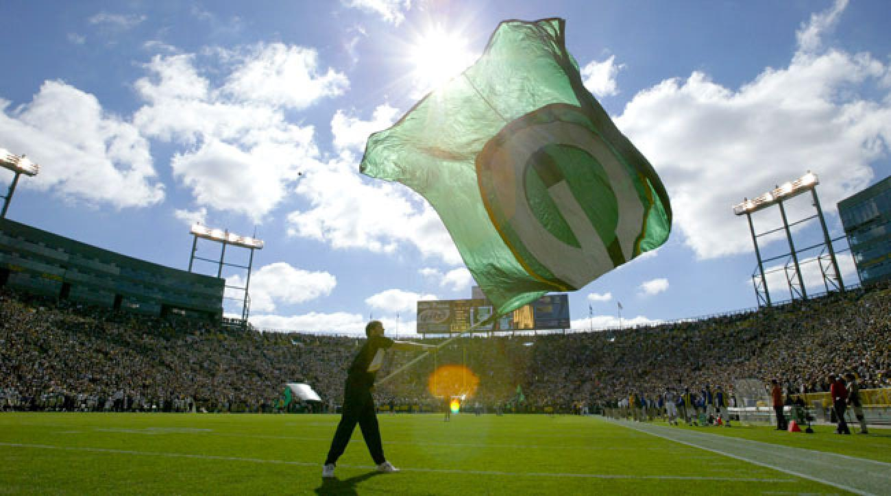 The Packers flag is flown before a game at Lambeau Field.