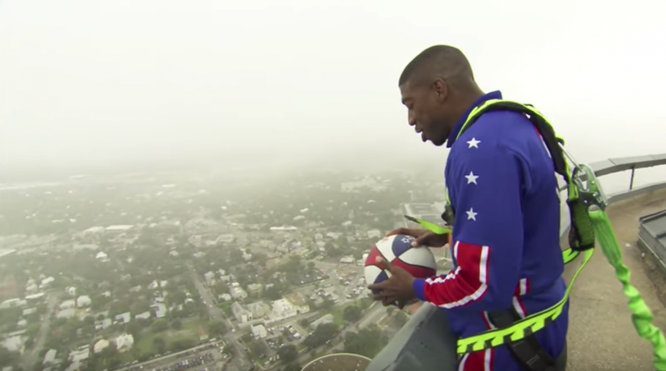 Globetrotter hits basketball trick shot from 583 feet (video)
