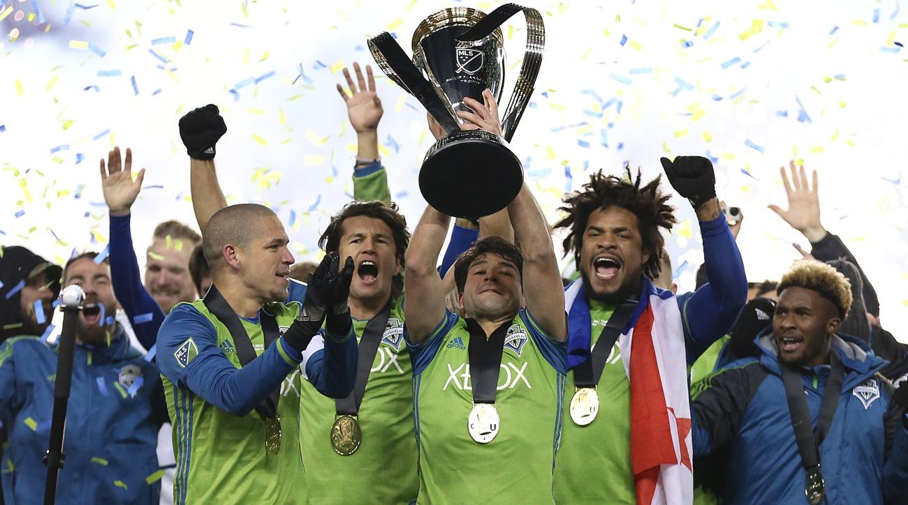 Nicolas Lodeiro lifts the MLS Cup with Seattle