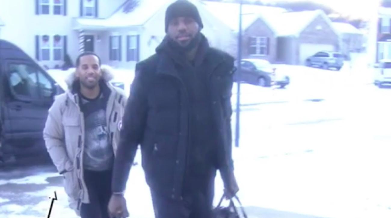 lebron james delivers prize money the wall
