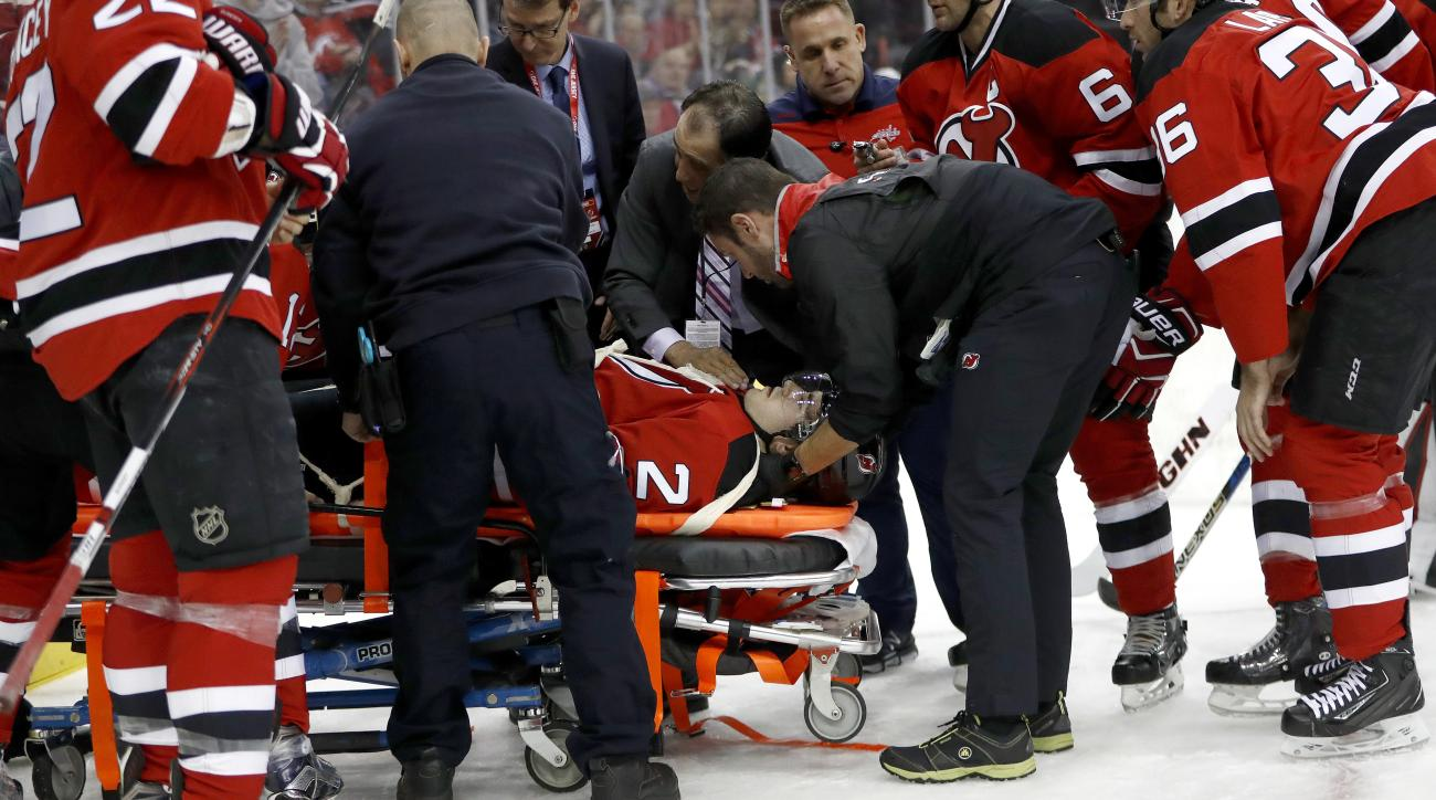 John Moore: Devils D on stretcher after hit (video)