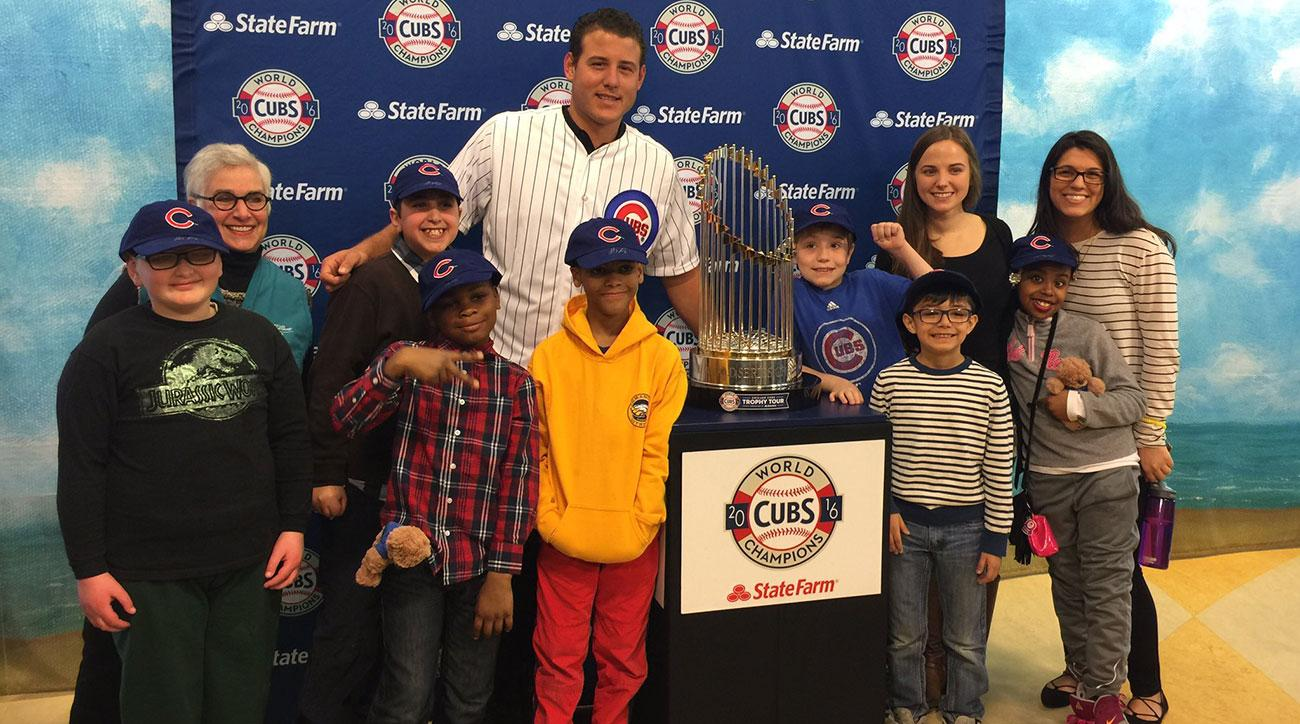 anthony rizzo visits hospital world series trophy