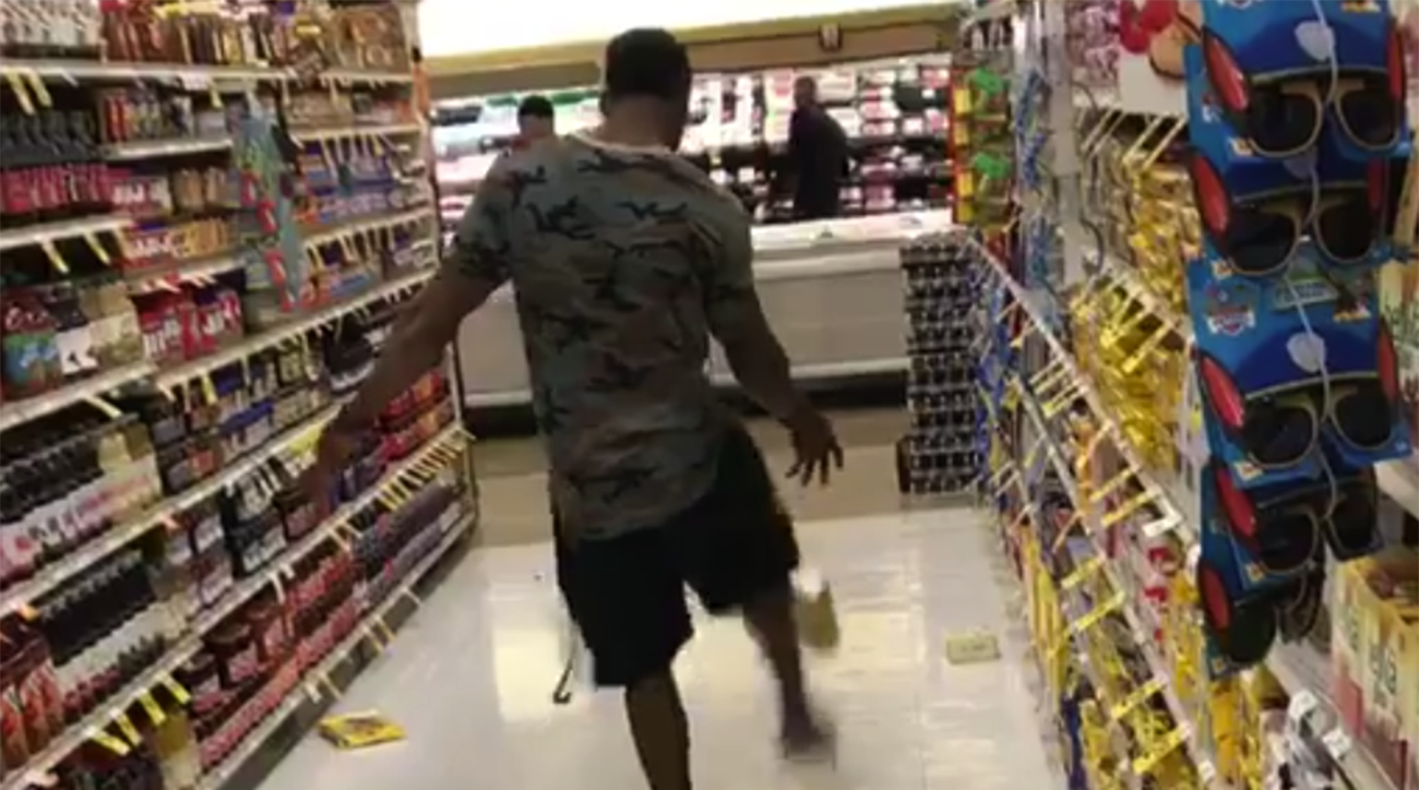 Marquette King punting groceries at grocery store (Video)
