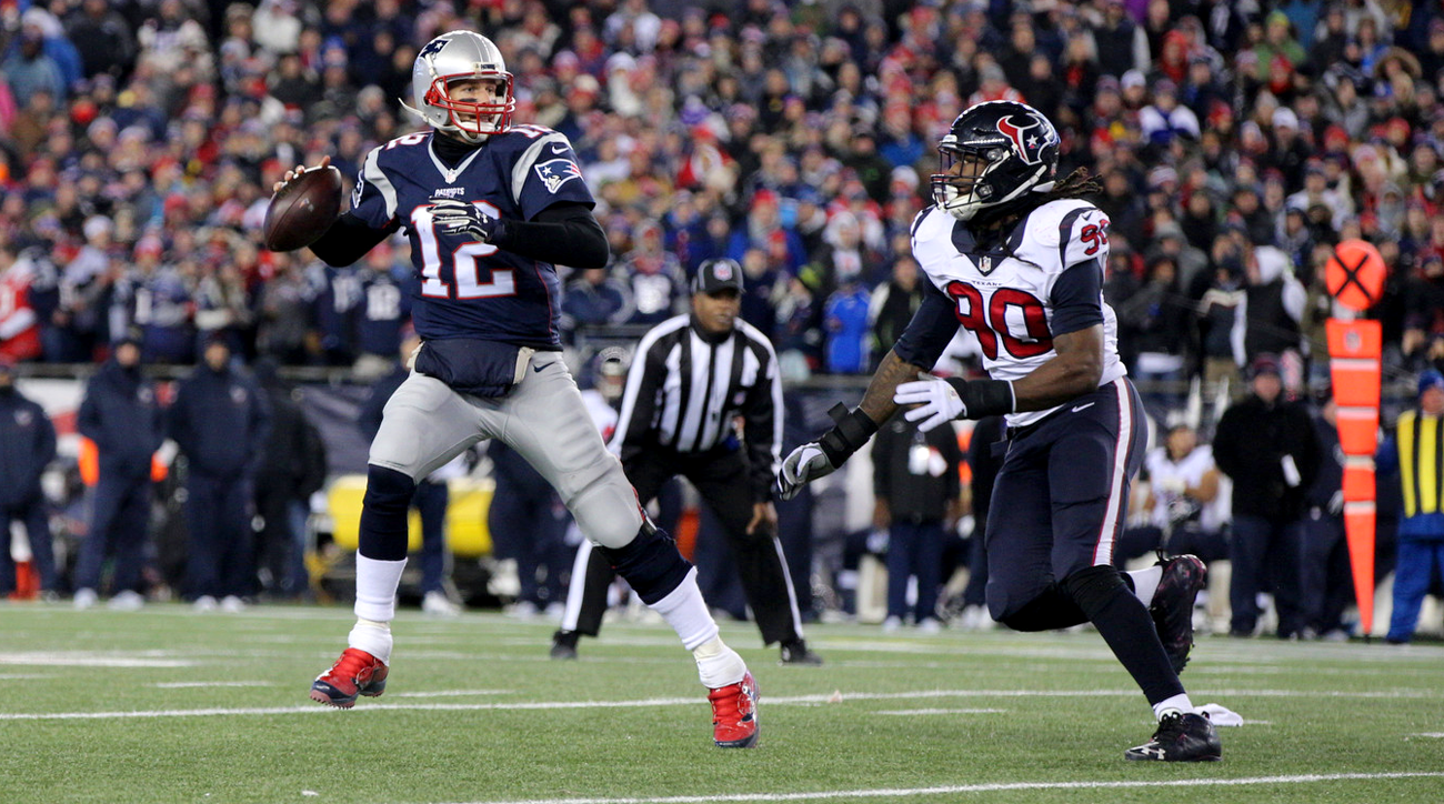 Tom Brady looks to throw with Jadeveon Clowney bearing down on him in last Sunday's AFC divisional game.