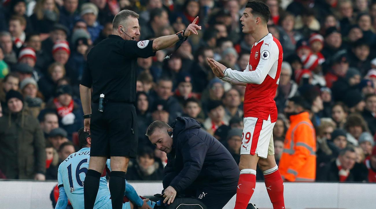 Arsenal's Granit Xhaka has been questioned for racially abusing an airport worker