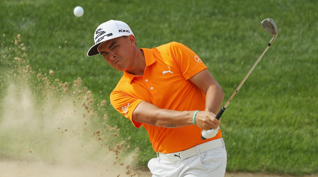 Rickie Fowler plays a bunker shot on the 3rd hole during the final round of the Abu Dhabi HSBC Championship.