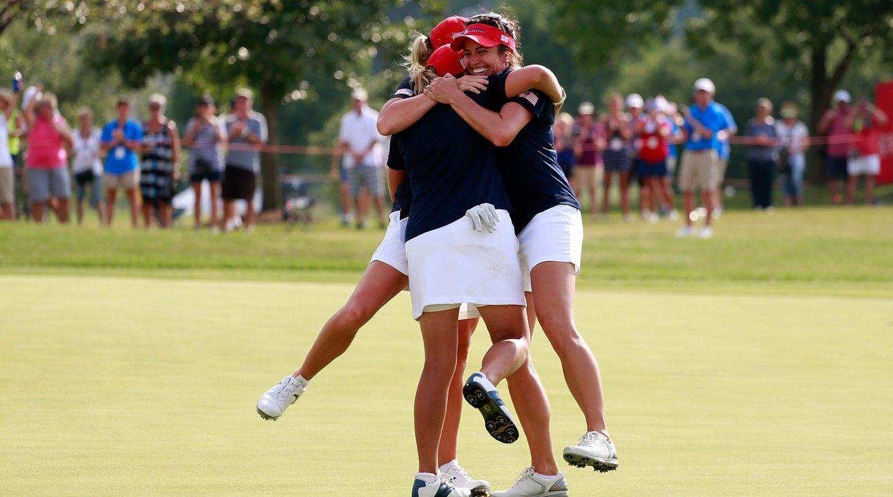 Team USA celebrate after their come-from-behind win at the 2016 UL International Crown.