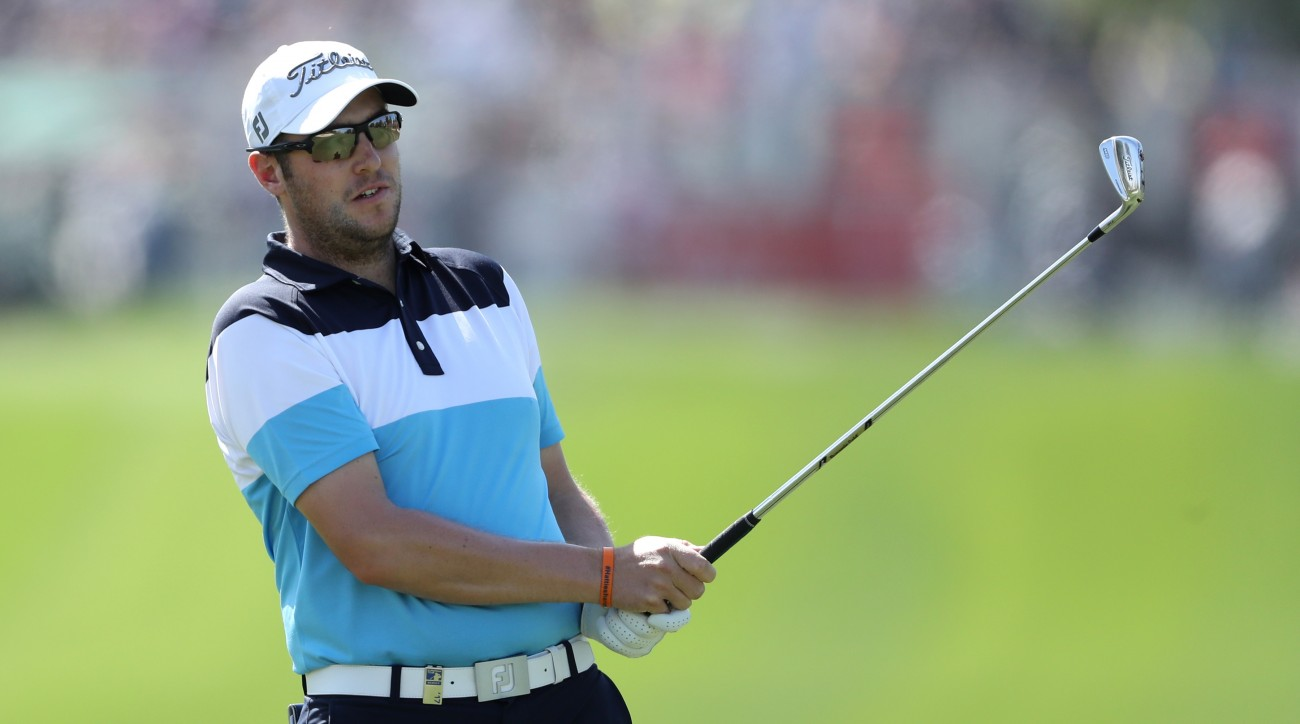 Matthew Southgate of England hits his second shot on the 1st hole during the third round of the Omega Dubai Desert Classic.