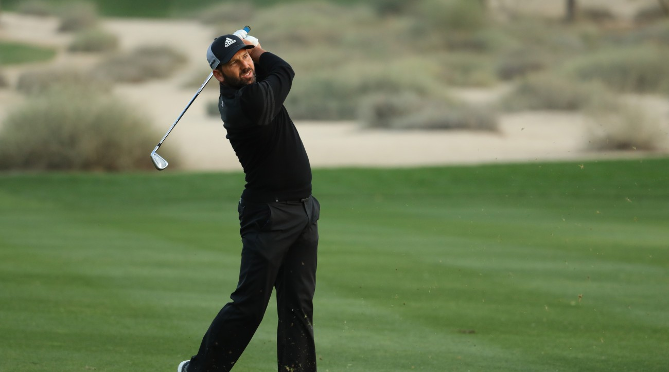 Sergio Garcia finished his third round at the Omega Dubai Desert Classic in darkness, up by three shots.