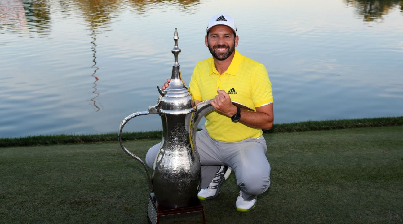 Sergio Garcia with the winner's trophy after round four of the Omega Dubai Desert Classic.