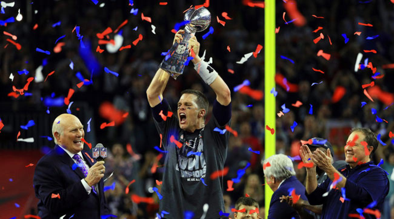 Tom Brady hoists the Lombardi Trophy after Super Bowl 51.