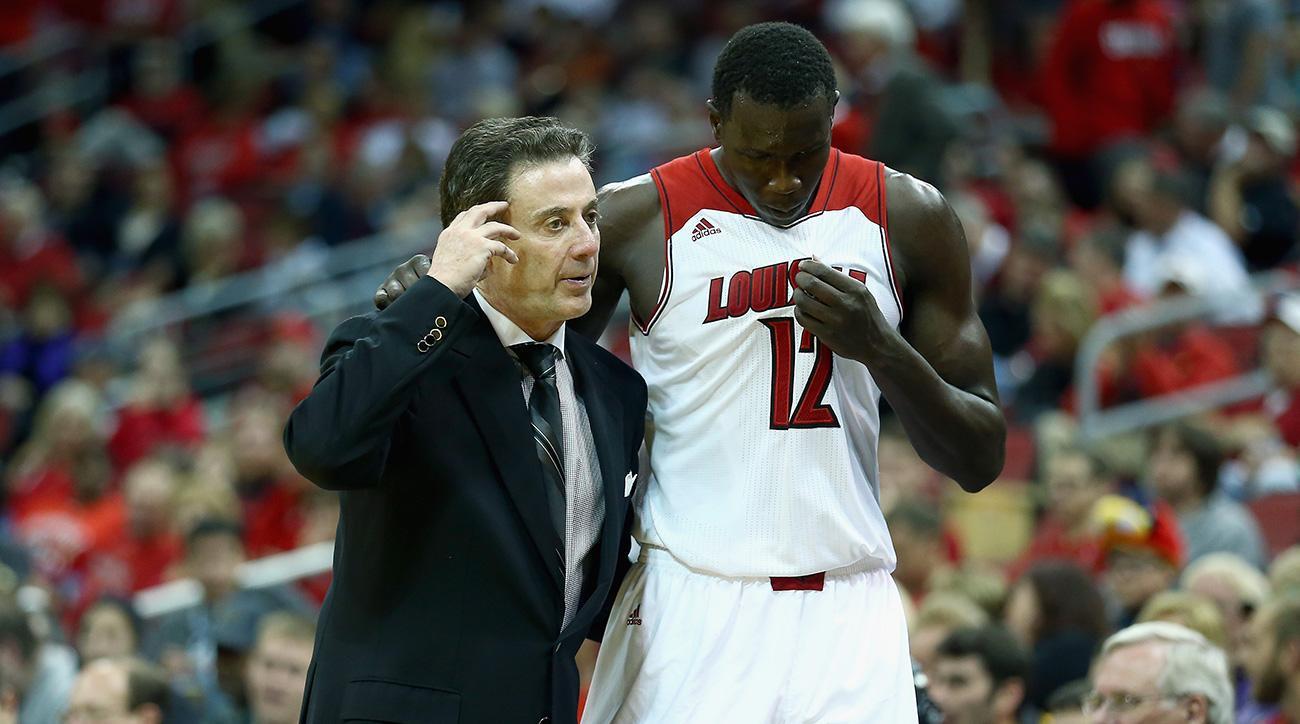 Louisville suspends Mathiang, Adel