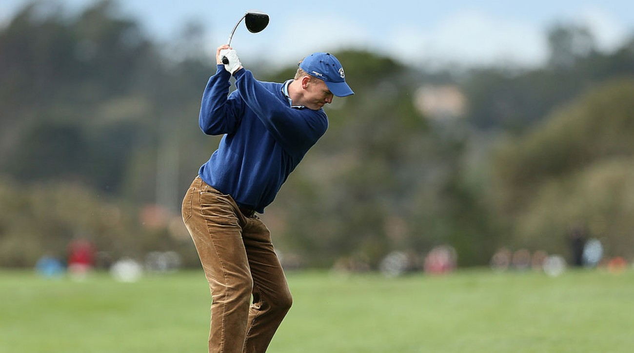 Peyton Manning hits a tee shot at the AT&T Pebble Beach Pro-Am in 2014.