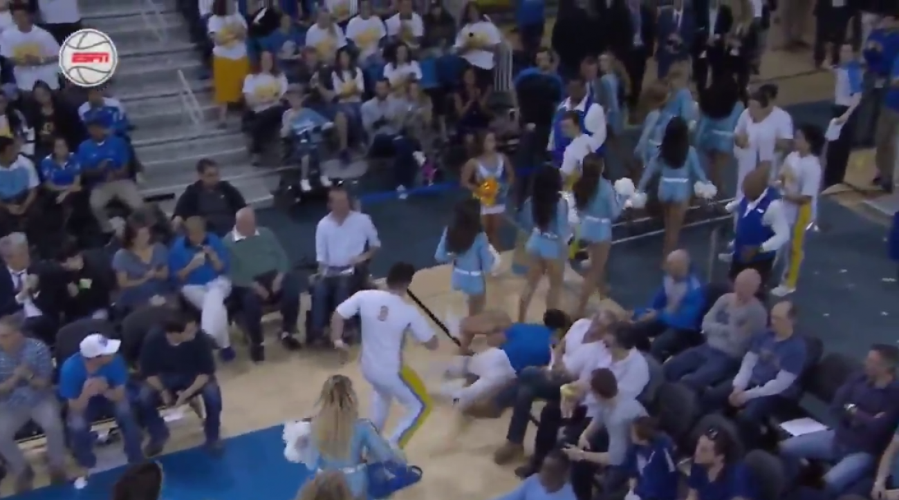 UCLA cheerleader falls, gets dropped by rescuer (video)