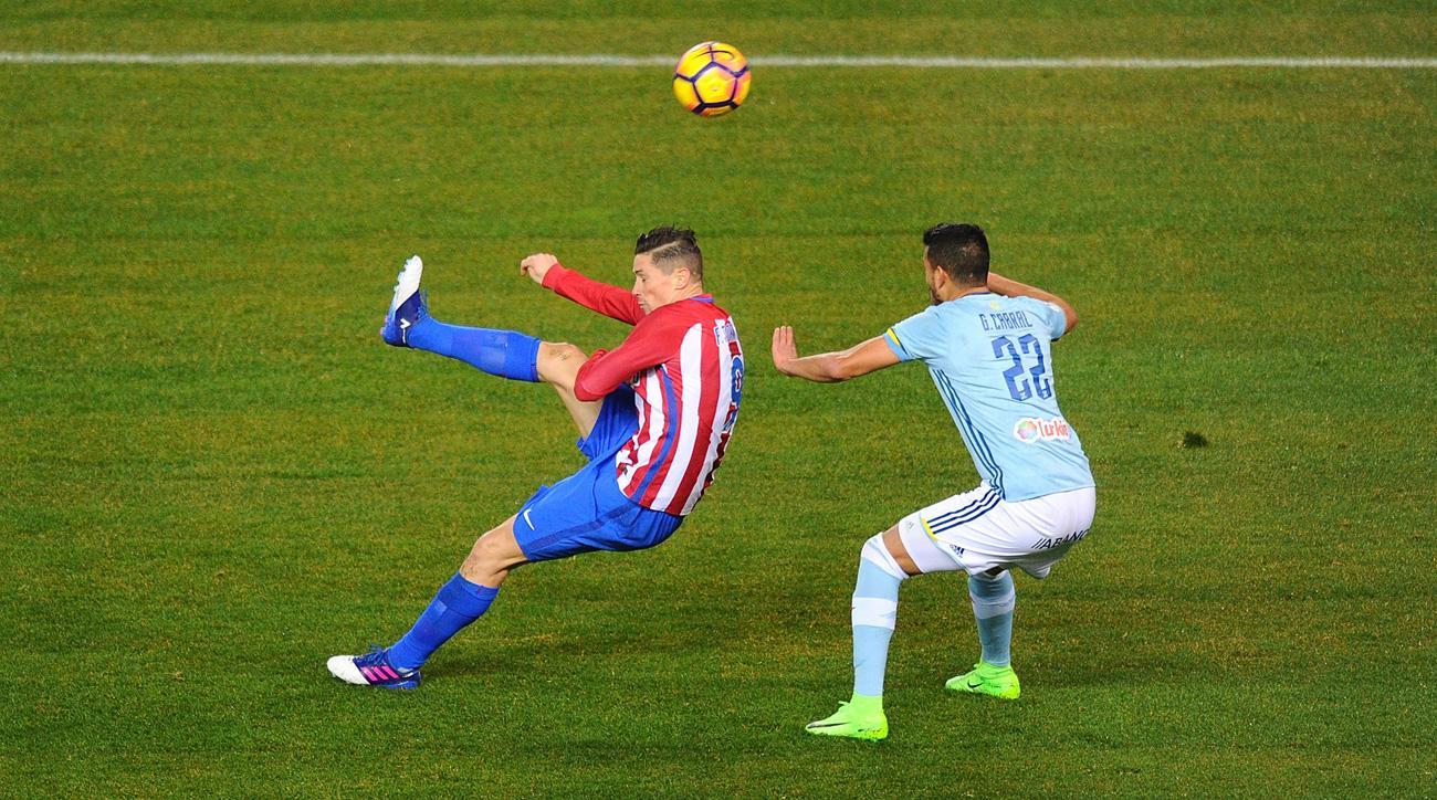 Fernando Torres scores an overhead kick for Atletico Madrid