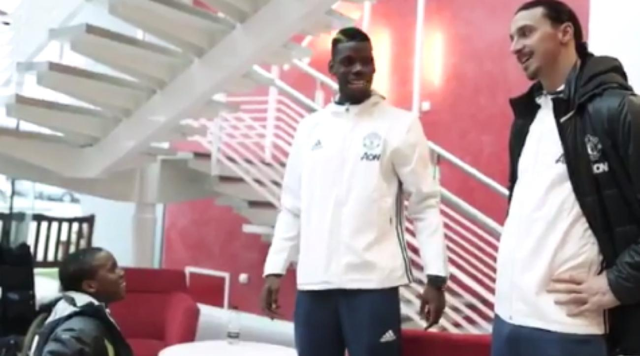 manchester united players surprise boy cerebral palsy