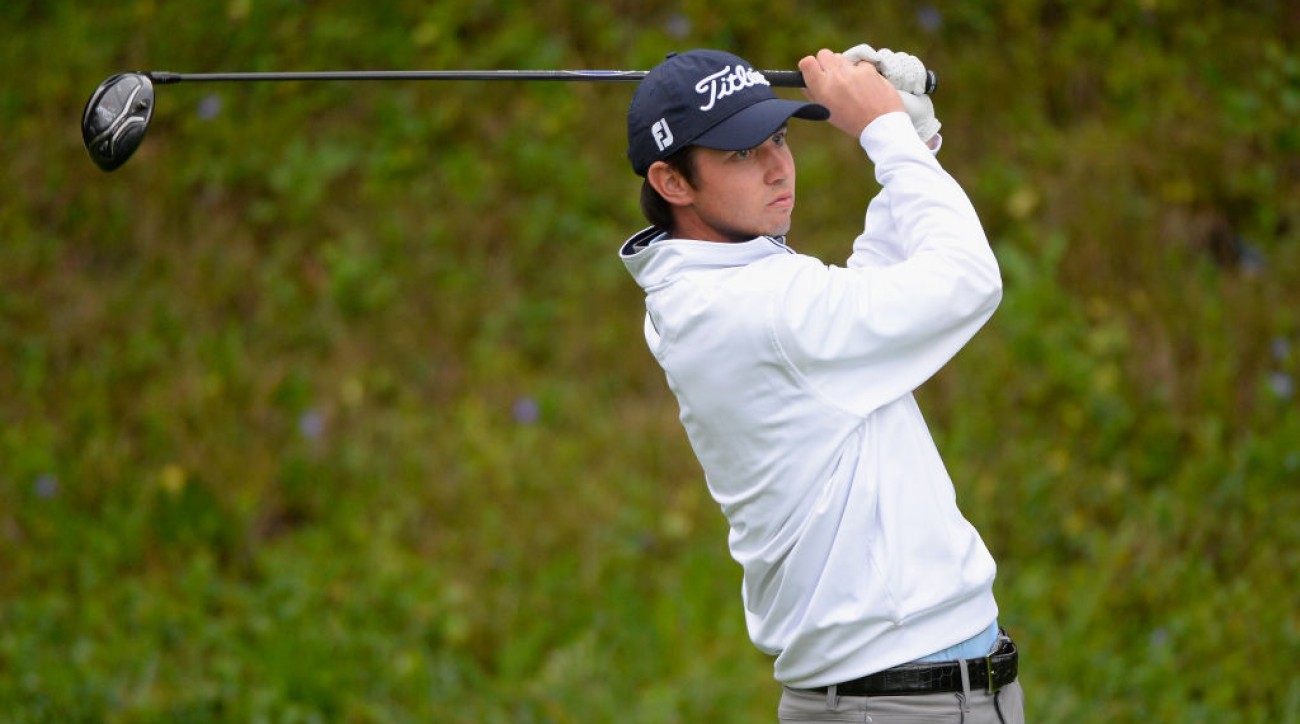 J.T. Poston plays his shot from the 13th tee during the third round at the Genesis Open.