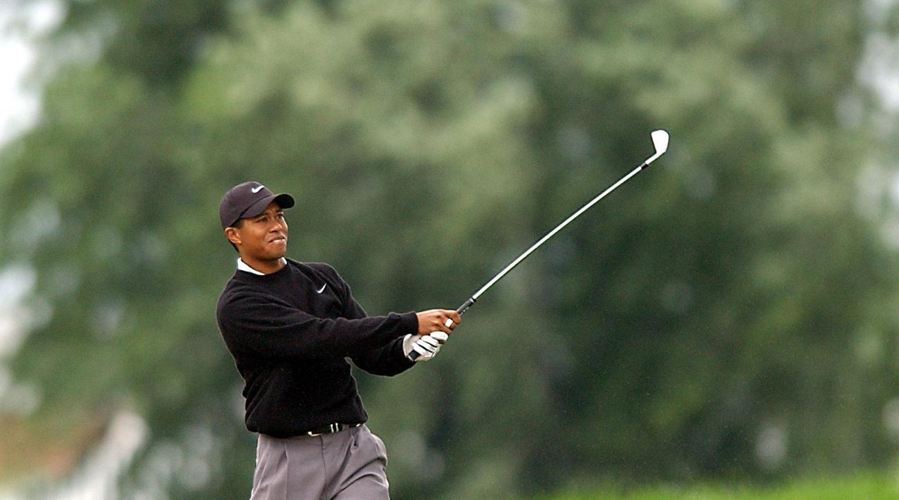 Tiger Woods would make birdie from a difficult lie off the tee, moving him to just two back after two rounds at the 2002 PGA Championship.