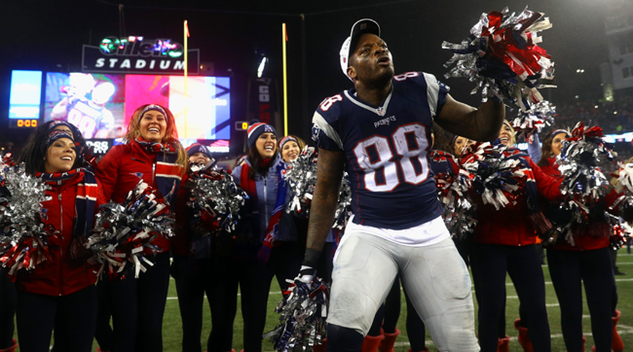 Martellus Bennett celebrates with Patriots cheerleaders.