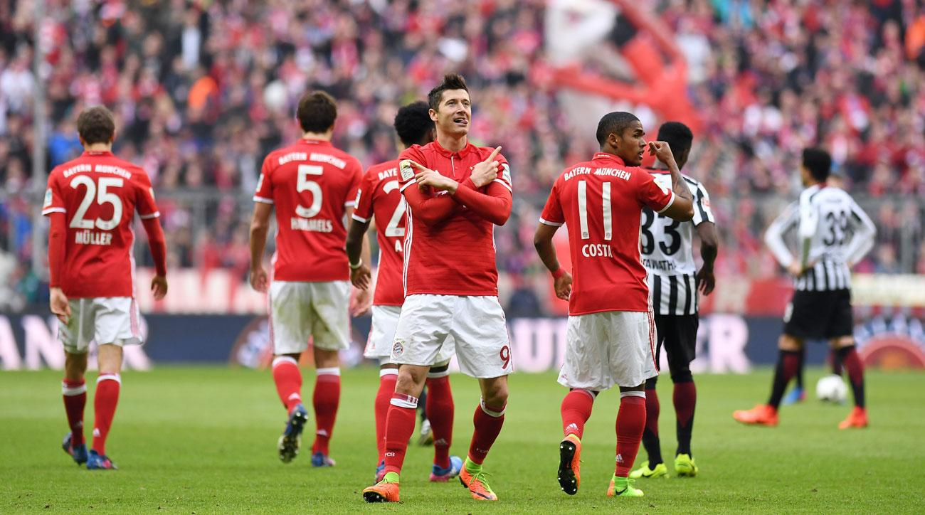 Robert Lewandowski leads Bayern Munich over Eintracht Frankfurt