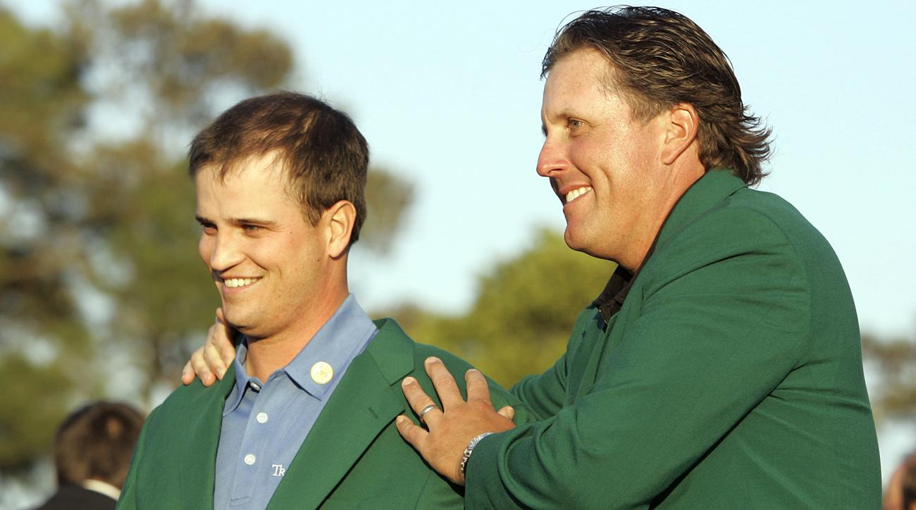 Zach Johnson receives the Masters green jacket from 2006 champion Phil Mickelson after winning the Masters in 2007.