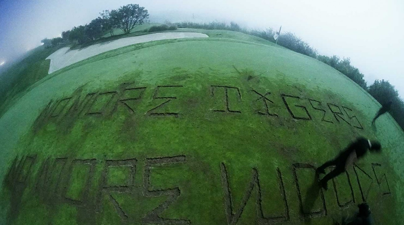An environmental group snuck onto a Trump golf course and cut a message into the fifth green.