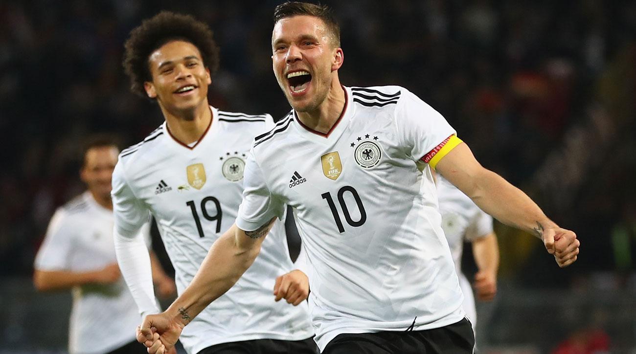 Lukas Podolski scores for Germany against England