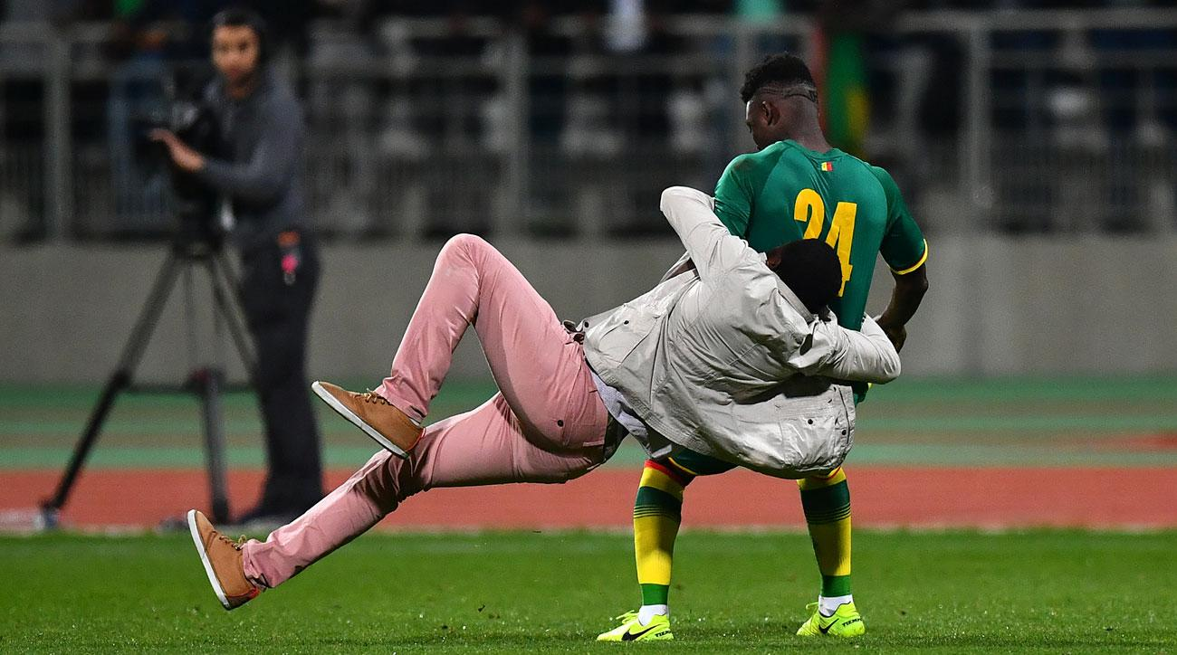 Ivory Coast and Senegal was called off early after a pitch invasion