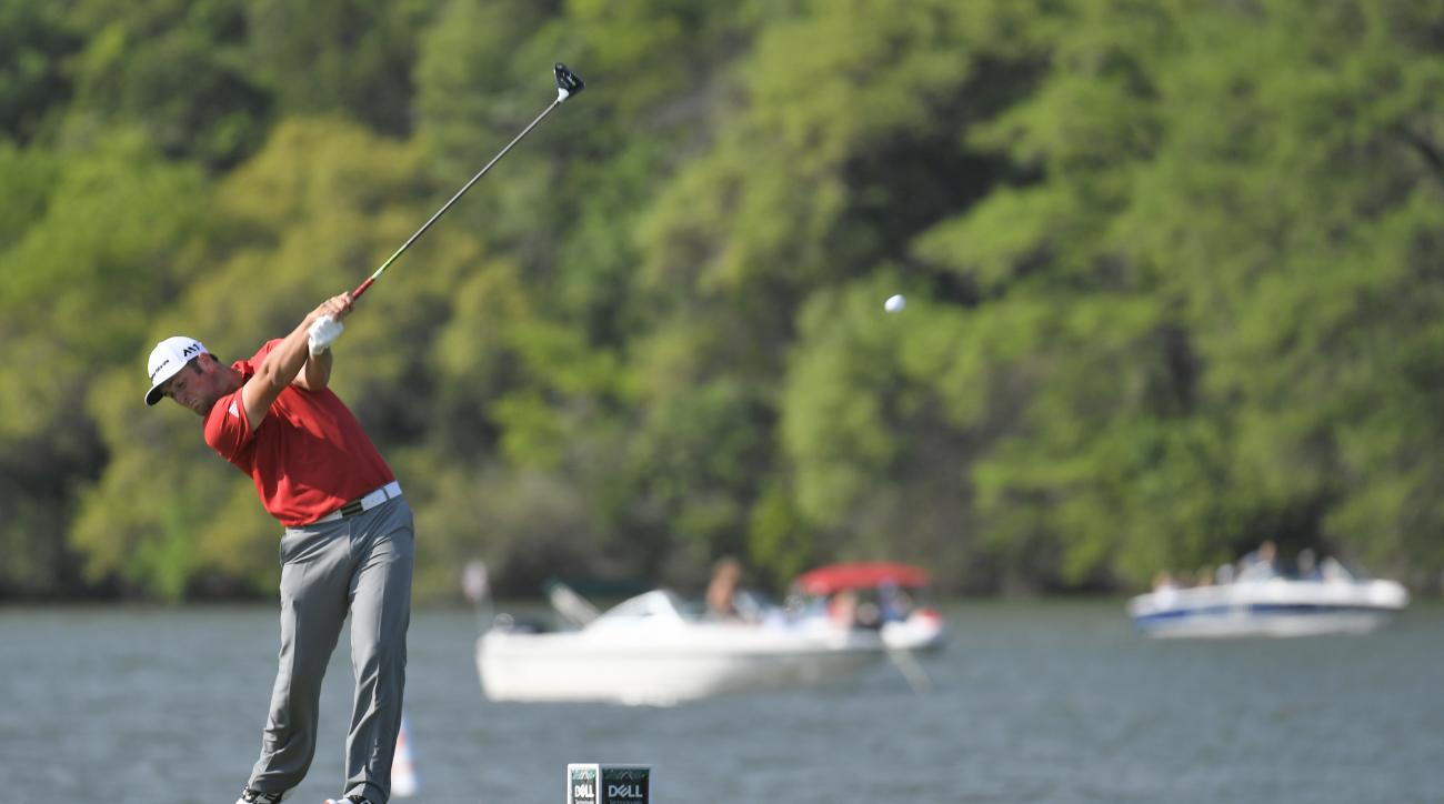 Jon Rahm of Spain plays a tee shot on the 14th hole during the championship match at the WGC-Match Play.