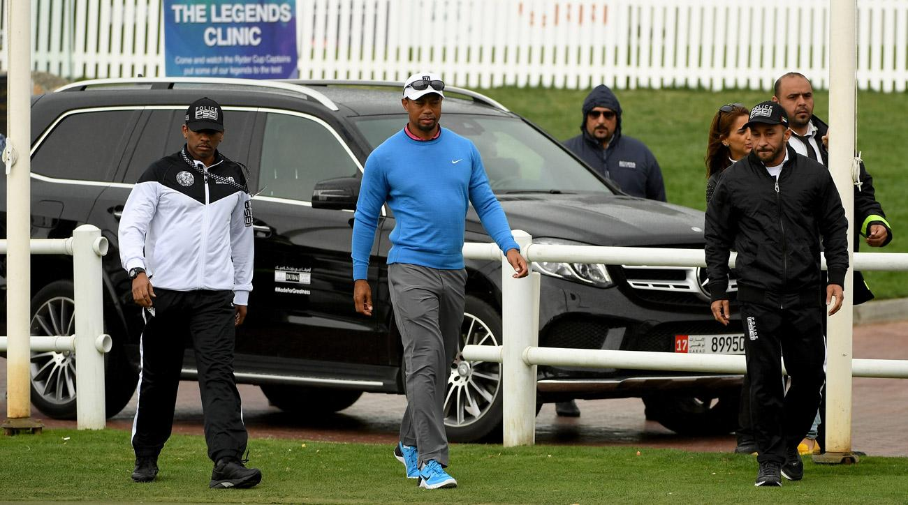 Tiger Woods walks gingerly after back spasms forced him to withdraw from the Dubai Desert Classic in early Feburary.
