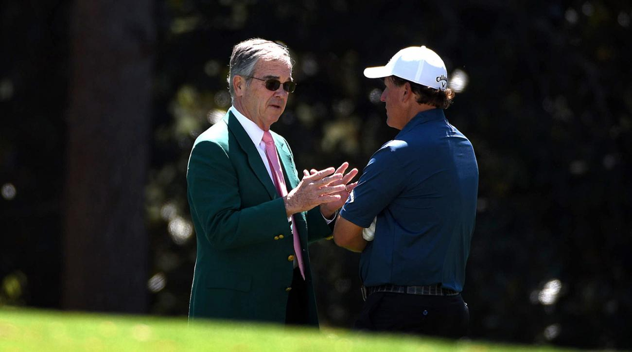 Augusta National chairman Billy Payne talks with Phil Mickelson Tuesday at the 2017 Masters.