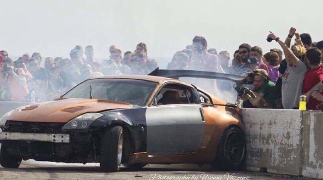 Watch: Photographer get smacked in the face by drift car's wing   SI.com