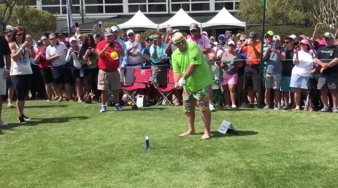 John Daly smashes a drive off a beer can at a Myrtle Beach fundraiser.