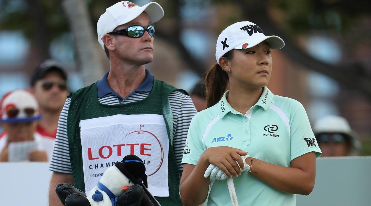 Lydia Ko of New Zealand  stands with her caddie Gary Matthews and bag during the final round of the LPGA LOTTE Championship.