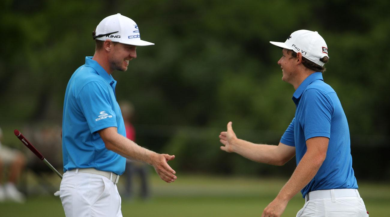 Jonas Blixt and Cameron Smith celebrate after making a putt on the 7th hole during the second round of the 2017 Zurich Classic.