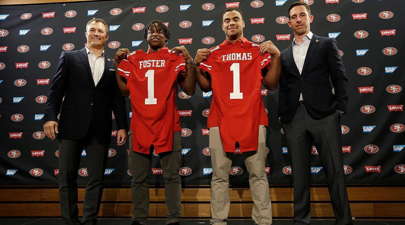Four rookies for the 49ers, from left: GM John Lynch, LB Reuben Foster, DE Solomon Thomas and head coach Kyle Shanahan.