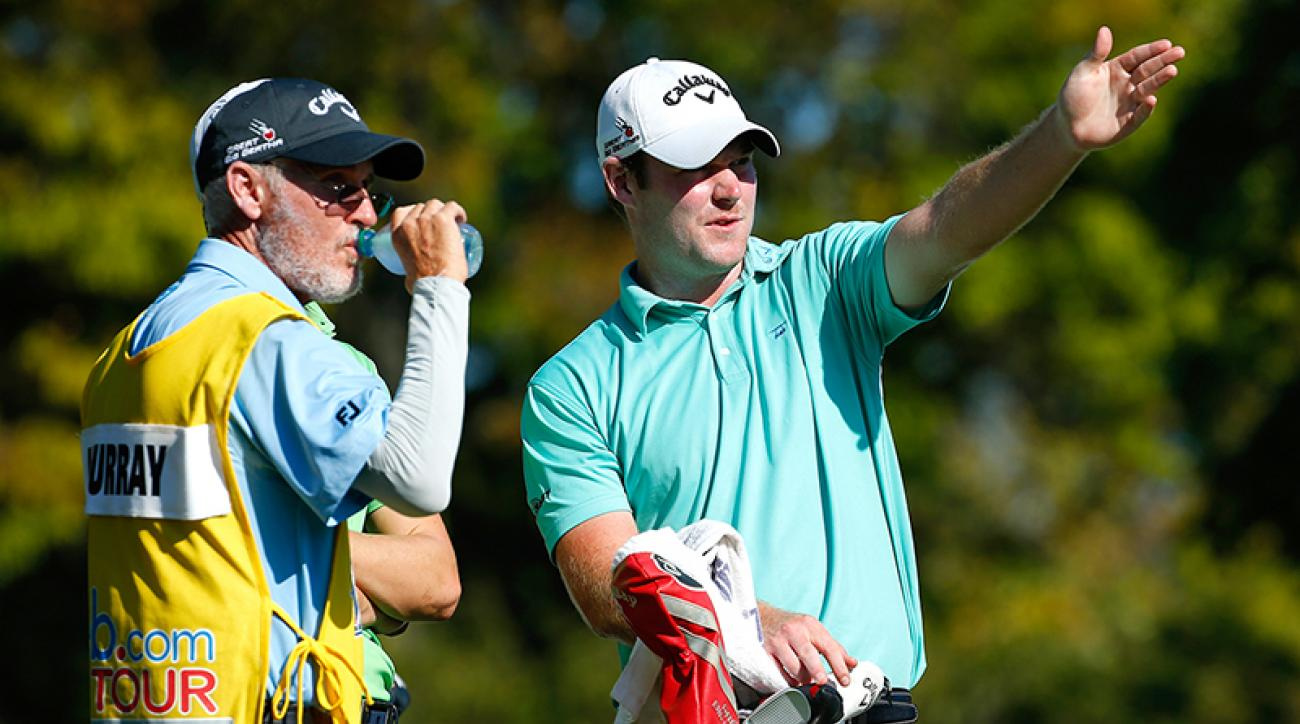 Grayson Murray and caddie Mike Hicks talk during the Web.com tour's Nationwide Children's Hospital Championship in 2016. Murray reportedly fired Hicks during their round Sunday at the Wells Fargo.