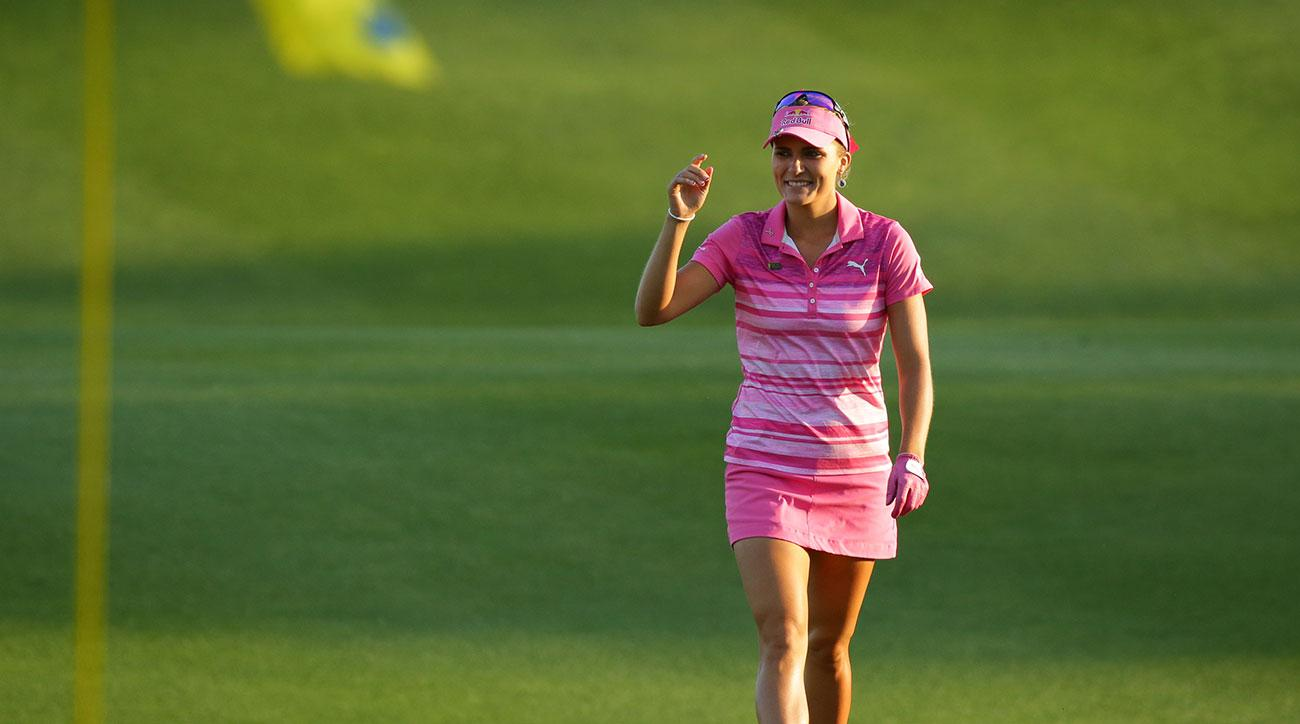 Lexi Thompson waves to the crowd as she walks to the green on the 18th hole during the third round of the Kingsmill Championship.