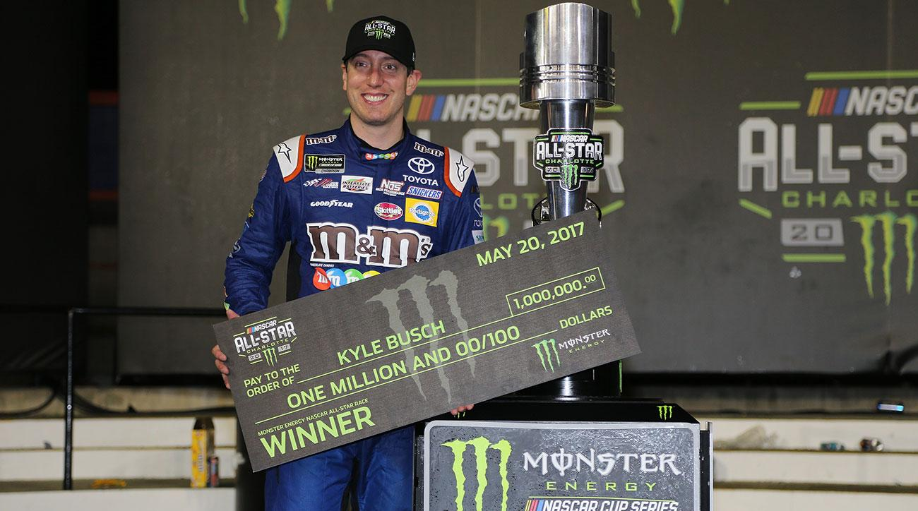 Kyle Busch, driver of the #18 M&M's Caramel Toyota, poses with the trophy after winning the Monster Energy NASCAR All Star Race at Charlotte Motor Speedway on May 20, 2017 in Charlotte, North Carolina.