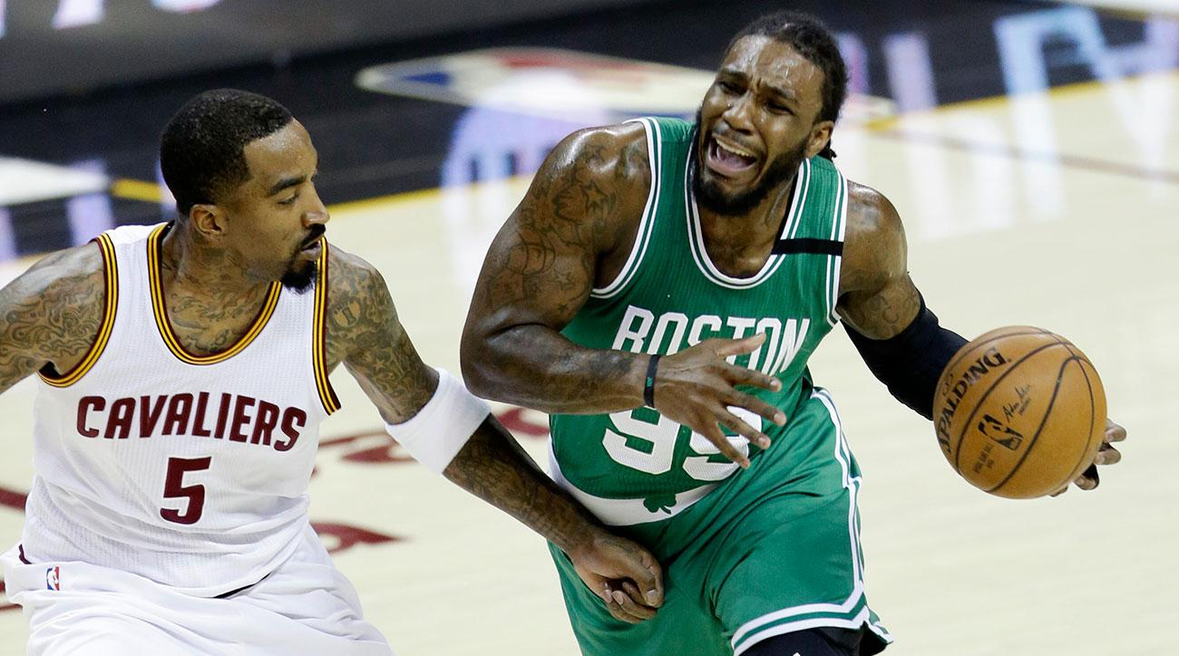 Boston Celtics' Jae Crowder (99) drives on Cleveland Cavaliers' J.R. Smith (5) during the first half of Game 4 of the NBA basketball Eastern Conference finals, Tuesday, May 23, 2017, in Cleveland. (AP Photo/Tony Dejak)