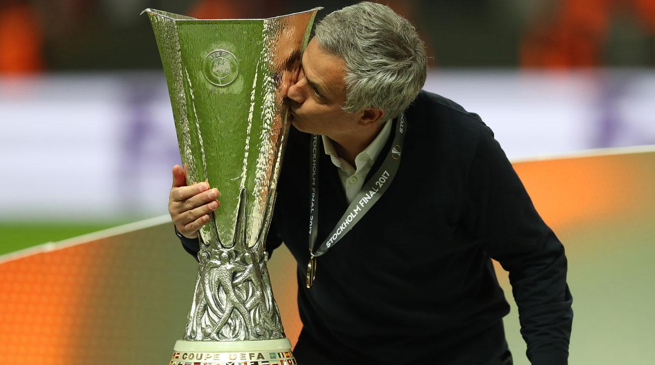 Jose Mourinho kisses the Europa League trophy after Manchester United's triumph in the final