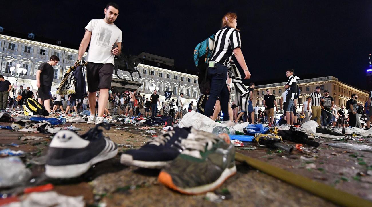 200 injured in Juventus fan panic after bomb scare