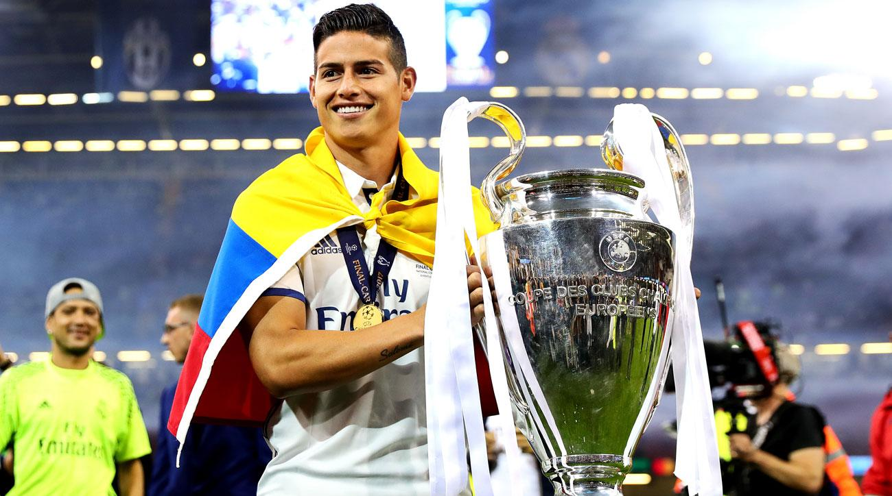 James Rodriguez lifts the Champions League trophy though he didn't play in the final for Real Madrid