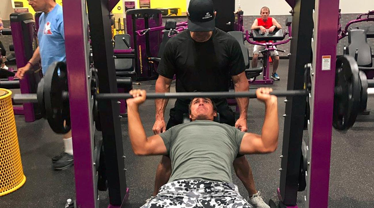 Brooks Koepka lifts weights Sunday morning before the final round of the U.S. Open.
