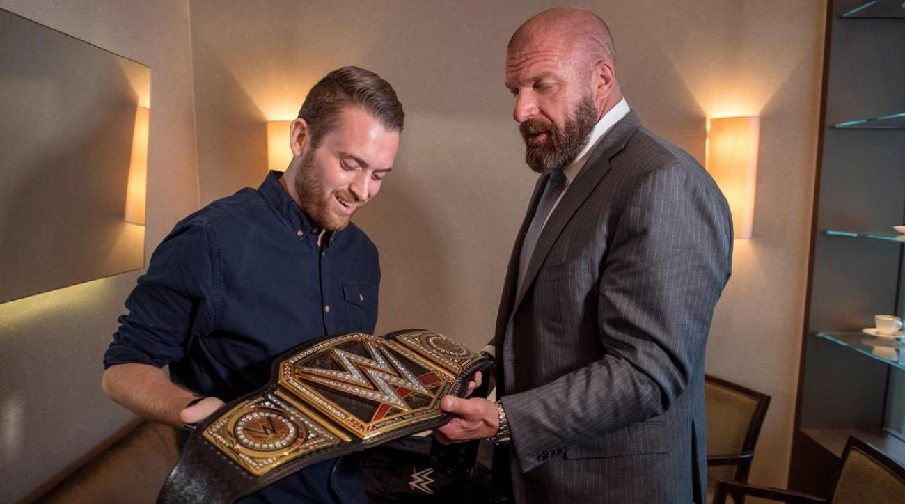 WWE's Triple H surprises London police officer with belt