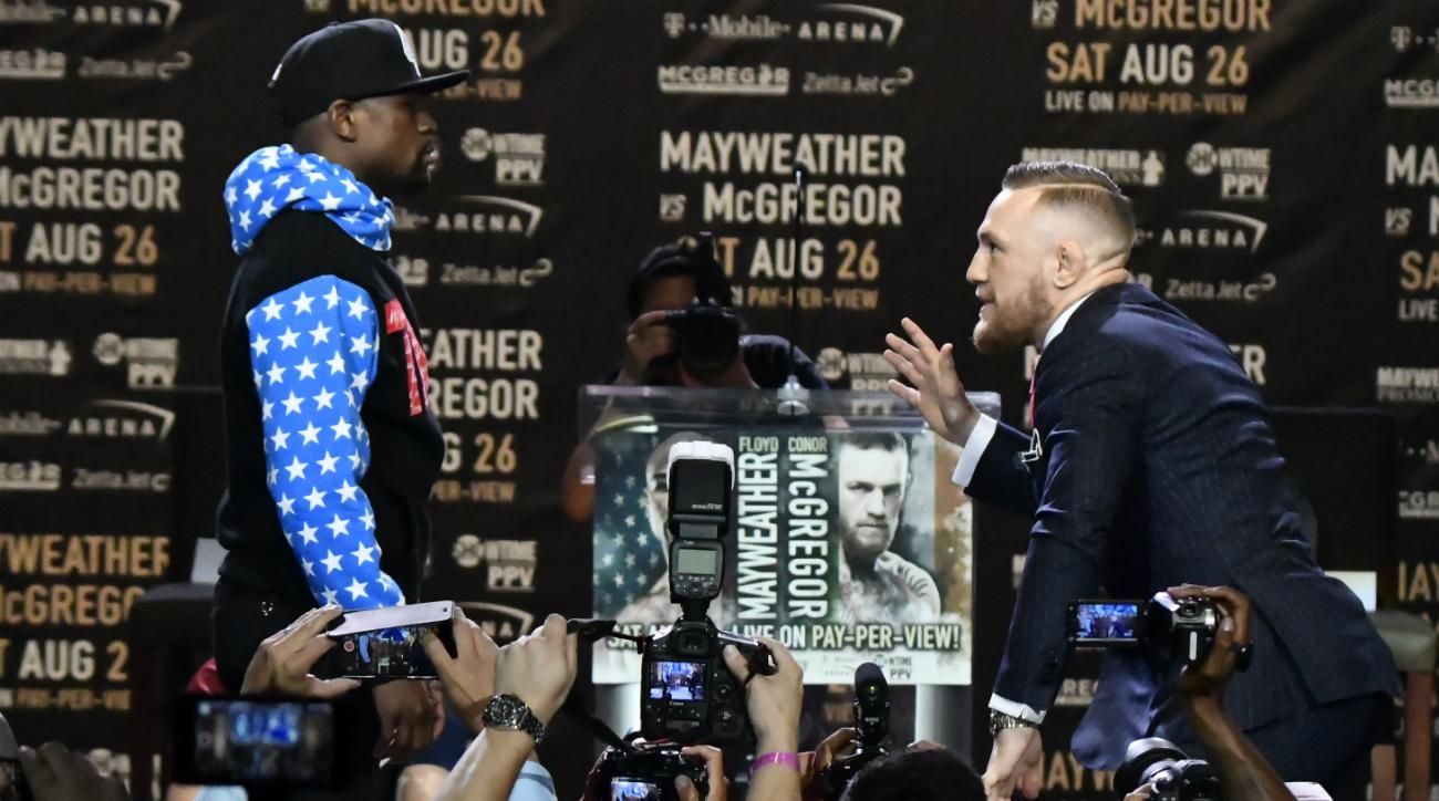 https://cdn-s3.si.com/s3fs-public/styles/marquee_large_2x/public/2017/07/12/floyd-mayweather-conor-mcgregor-press-conference.jpg