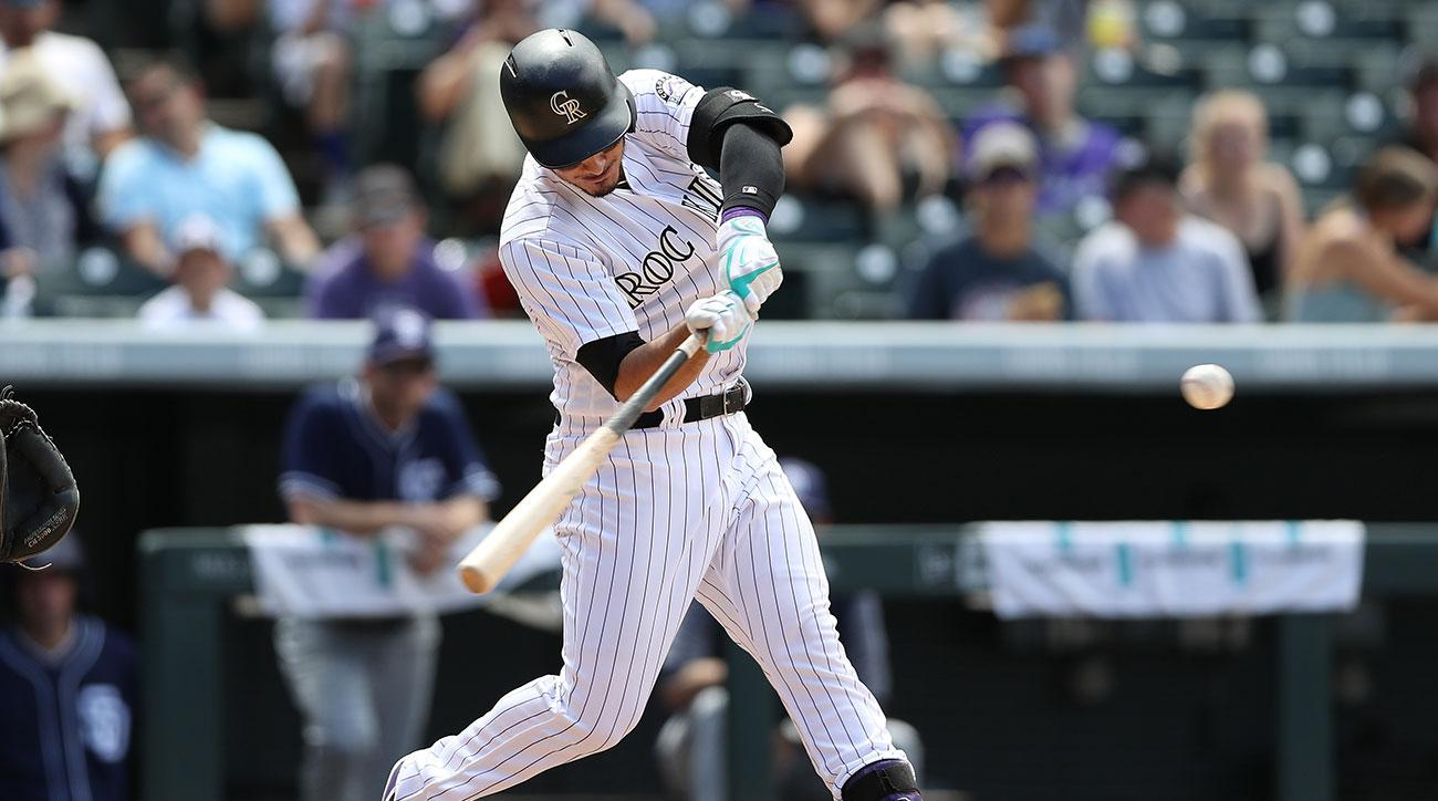 olan Arenado #28 of the Colorado Rockies hits a home run in the fourth inning against the San Diego Padres at Coors Field on July 19, 2017 in Denver, Colorado. (Photo by Matthew Stockman/Getty Images)