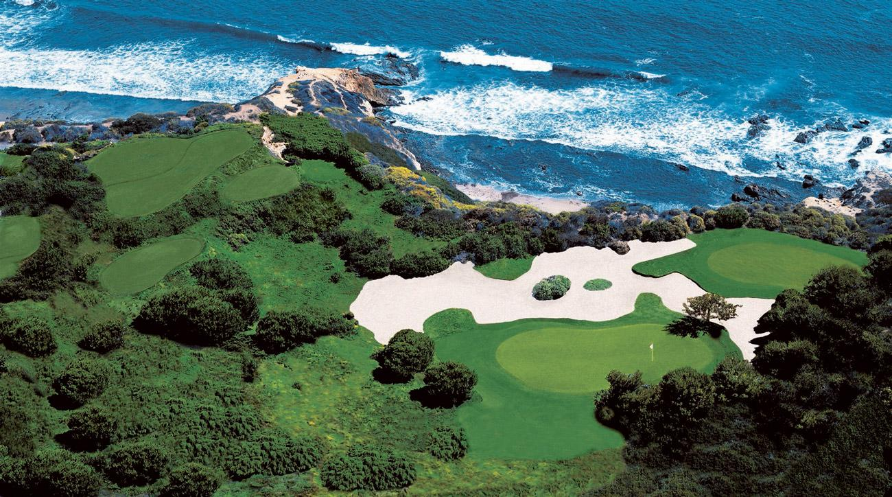An aerial view of the majestic 123-yard par-3 13th hole at Pelican Hill's Ocean South Course.